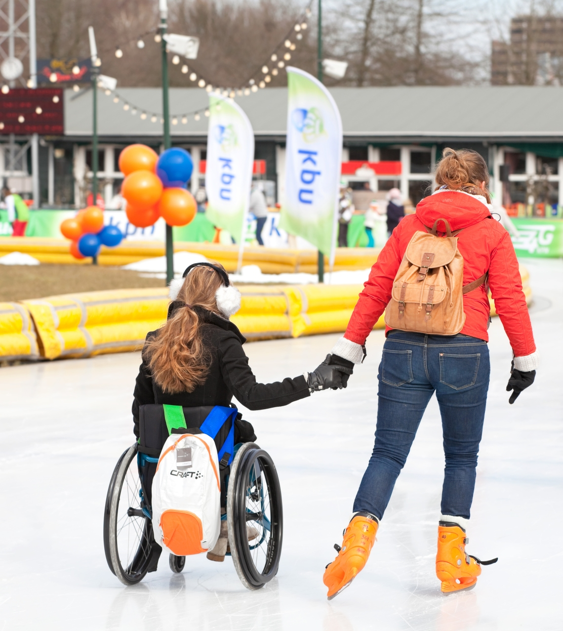 two-women-one-in-wheelchair-ice-skating