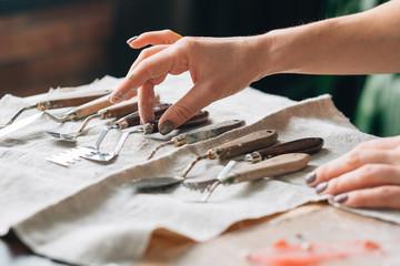 palette knives on ivory textile